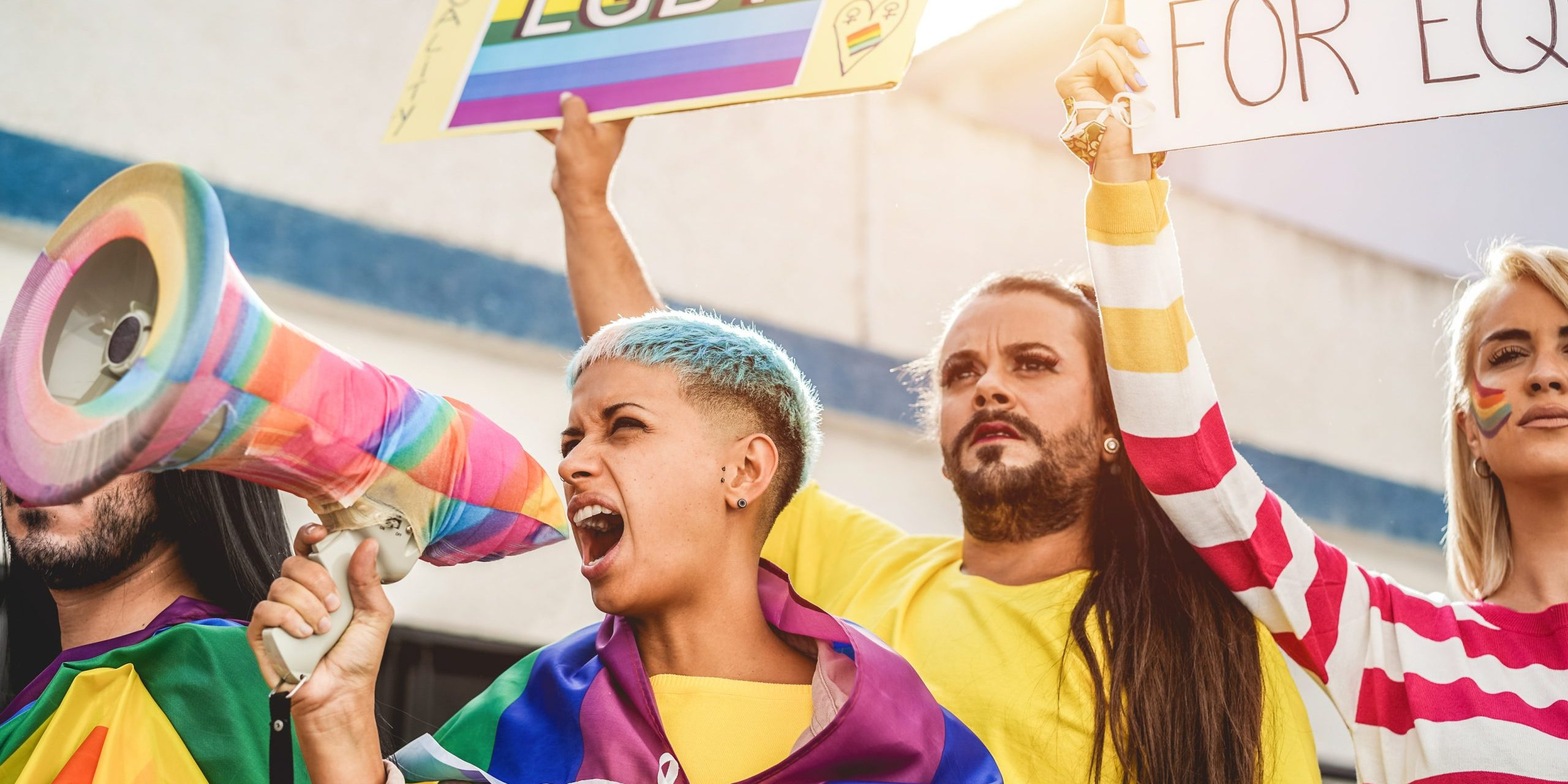 Gay and transgender people protest at pride event outdoor- Lgbt and equality rights concept - Focus on girl screaming